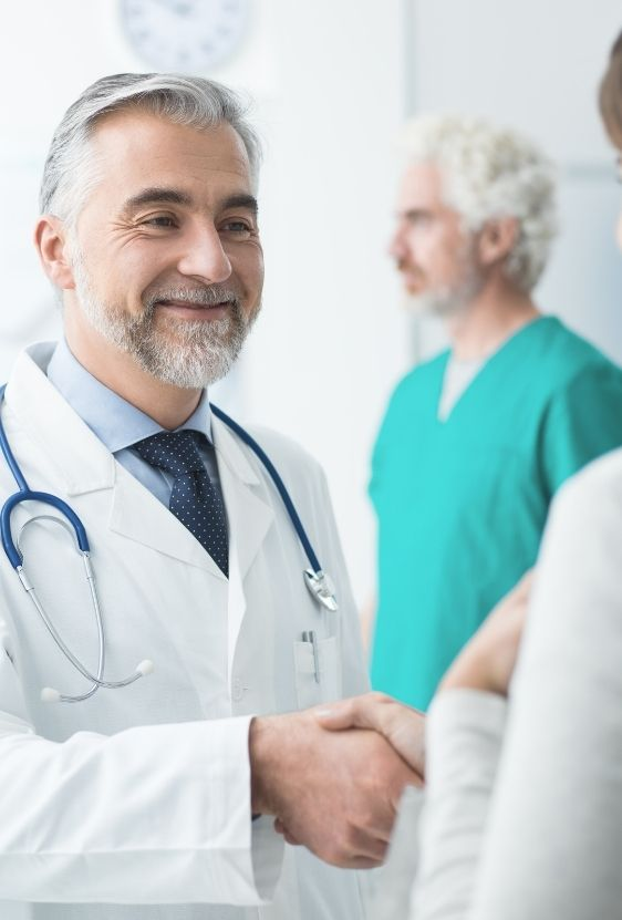 a doctor greeting his patient